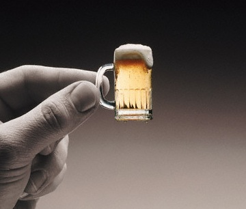 holding tiny little beer mug